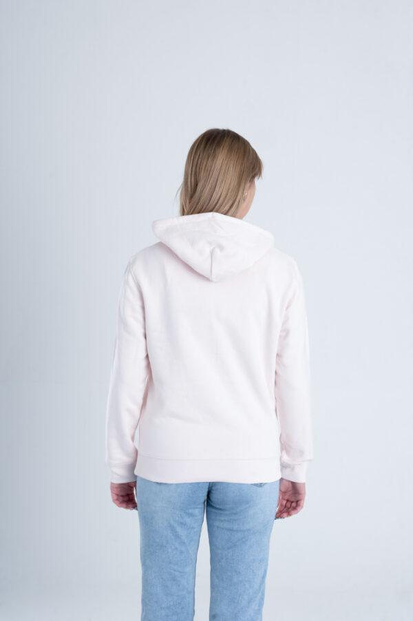 Vrouw met Duurzame premium hoodie trui Licht roze achterkant